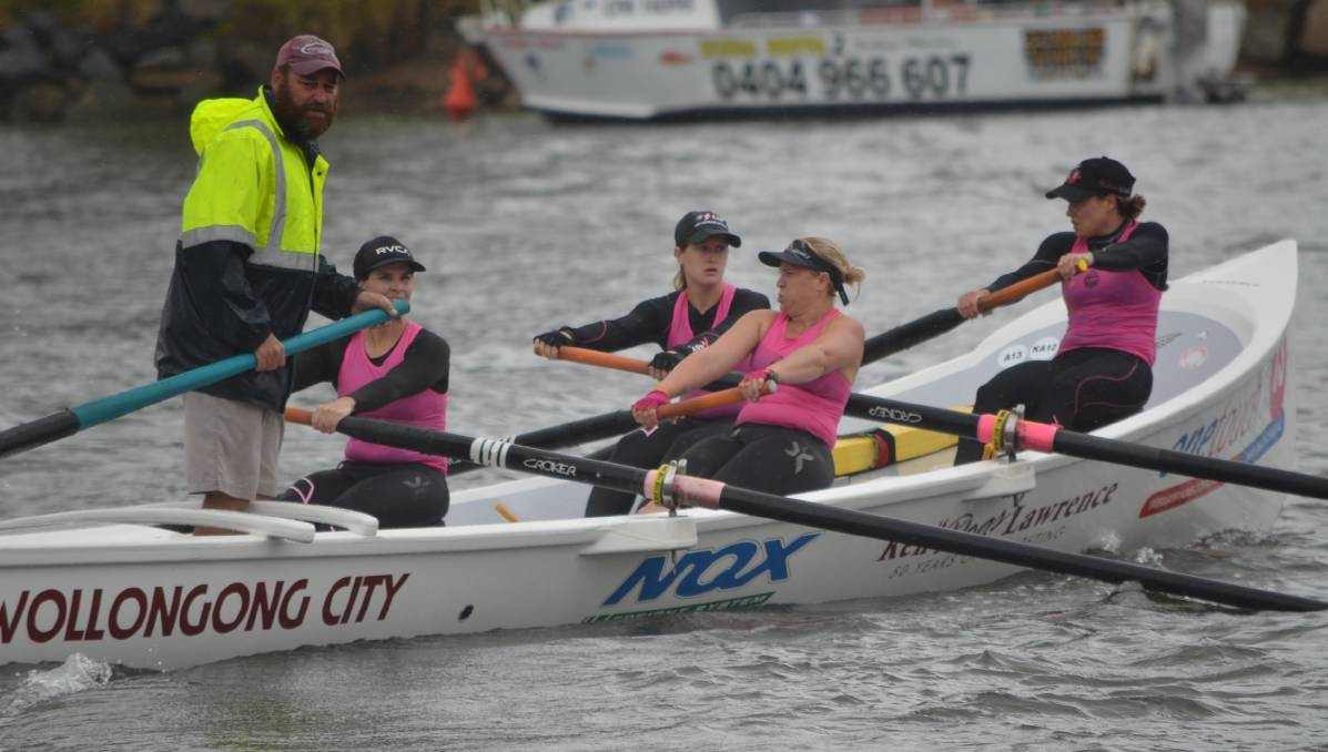 That's a paddlin: The Wollongong City women's crew, with sweep Brett Dingwall  (left) steering, negotiate the Moruya River Picture: Sam Strong