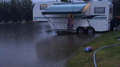 A flooded Moruya Showground, across the road from Moruya High School  where George Bass competitors were camping on Sunday night. Low-lying parts of Moruya have been inundated in the downpour.